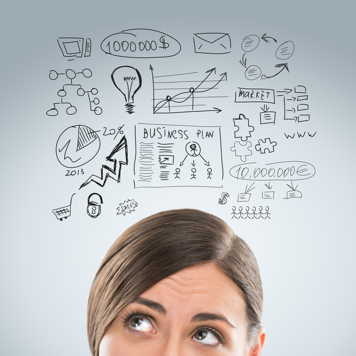 Young business woman thinking of her plans closeup face portrait